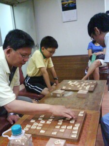 Mr Yeo and his son, playing against Ryou