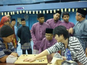 Demonstrating the game in Pusat Belia