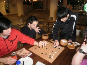 Xinwen reviewing a game
