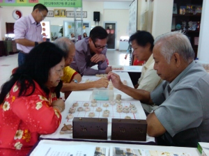 President of Brunei Chinese Chess Federation giving teaching game