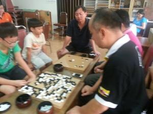 Jacky Yin playing with a member of Malaysia Weiqi Association