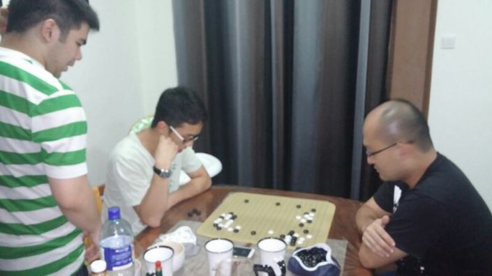 Chung Sun giving a teaching game to David